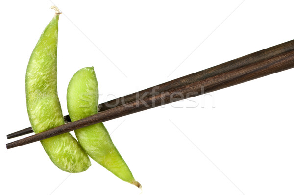 Soy beans with chopsticks Stock photo © elenaphoto