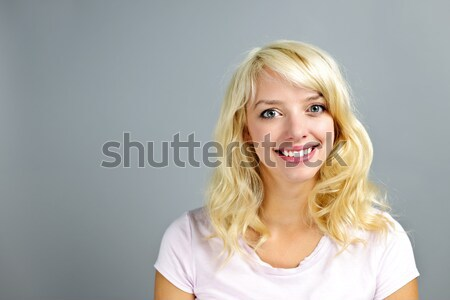Happy  young woman smiling Stock photo © elenaphoto