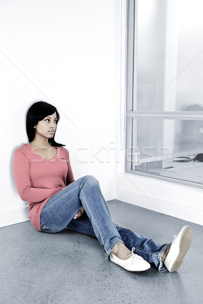 Depressed woman sitting on the floor Stock photo © elenaphoto