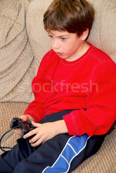 Boy video game Stock photo © elenaphoto
