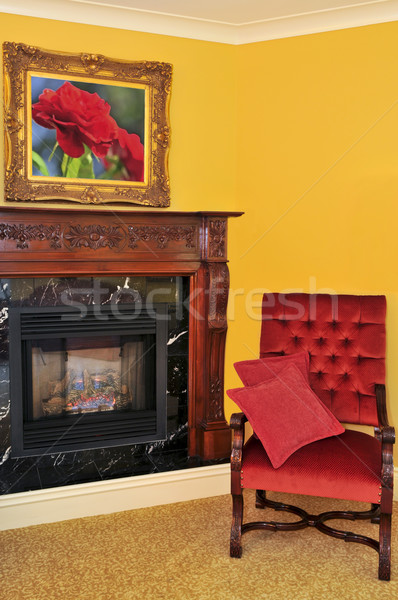 Fireplace and red chair Stock photo © elenaphoto
