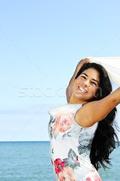 Beautiful young woman at beach Stock photo © elenaphoto