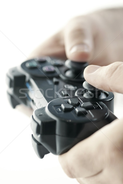 Hands with game controller Stock photo © elenaphoto