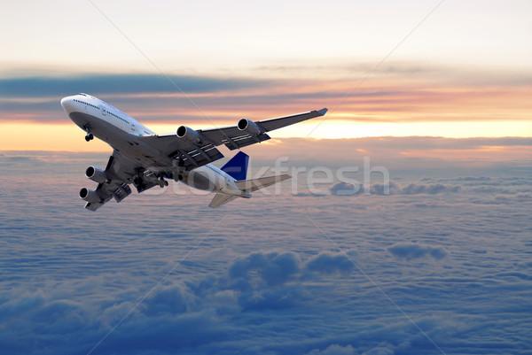 Fölött felhők nagy repülőgép repülés naplemente Stock fotó © elenaphoto
