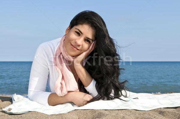 Young native american woman at beach Stock photo © elenaphoto