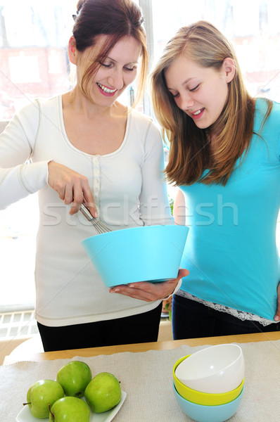 Mother and daughter cooking  Stock photo © elenaphoto