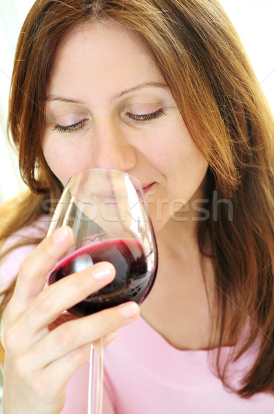 Mature woman with a glass of red wine Stock photo © elenaphoto