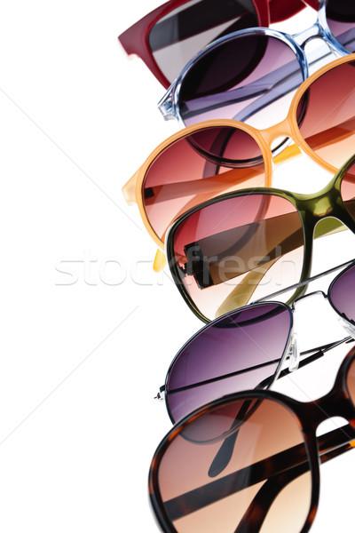 Zonnebril verschillend stijlen witte glas achtergrond Stockfoto © elenaphoto