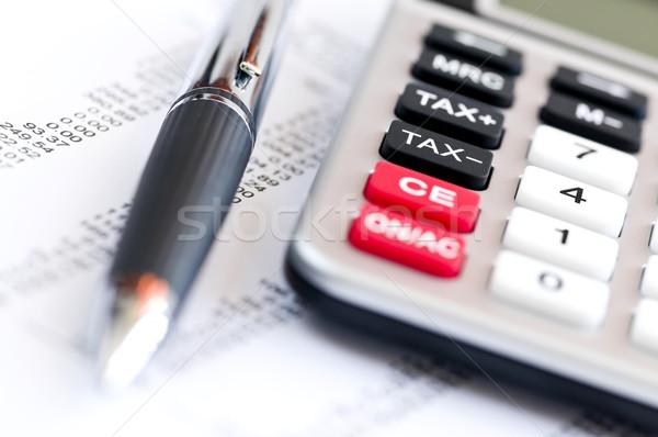 Stock photo: Tax calculator and pen