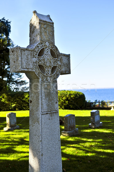 Graveyard with celtic cross Stock photo © elenaphoto