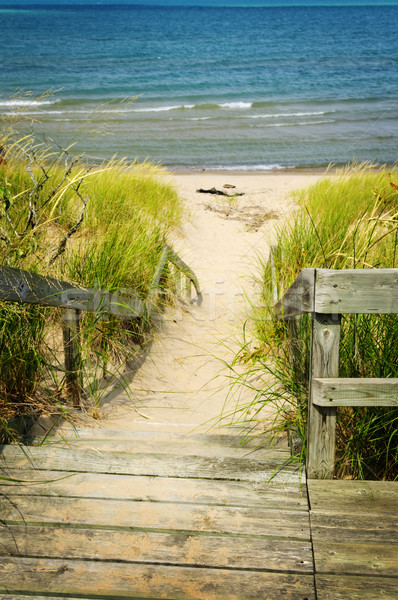 Stock photo: Wooden stairs over dunes at beach