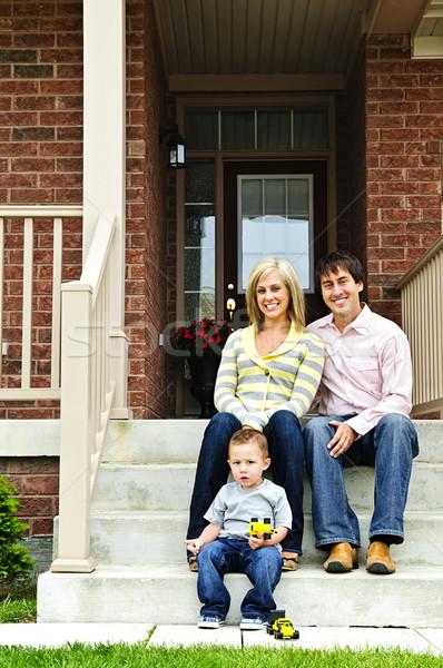 Gelukkig gezin home jonge familie vergadering Stockfoto © elenaphoto