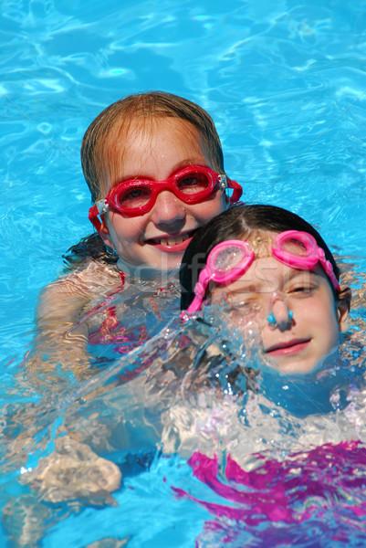 Two girls pool Stock photo © elenaphoto