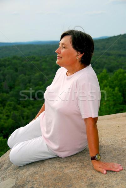 Woman edge cliff Stock photo © elenaphoto
