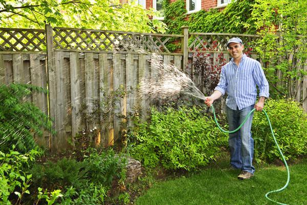 Man watering garden Stock photo © elenaphoto