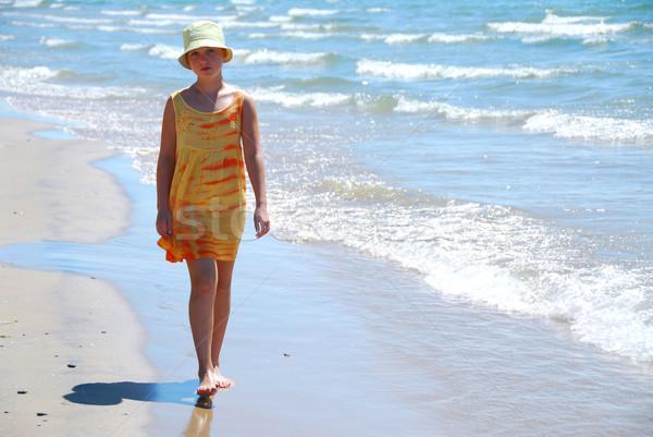 Girl walk beach Stock photo © elenaphoto