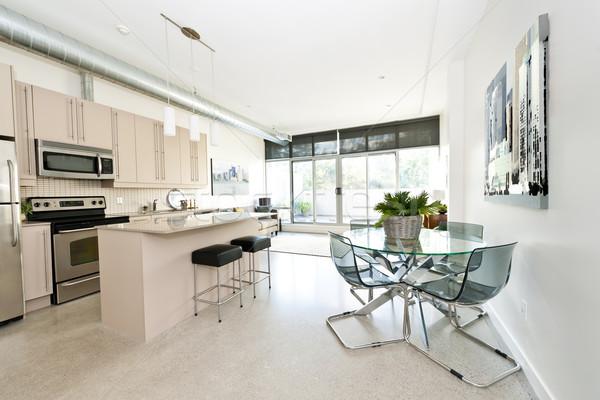 Modern condo kitchen dining and living room Stock photo © elenaphoto