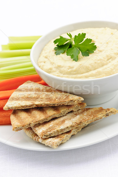 Stock photo: Hummus with pita bread and vegetables