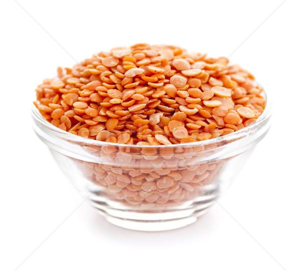 Bowl of uncooked red lentils Stock photo © elenaphoto