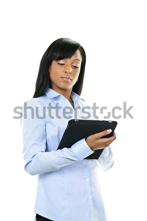 Serious woman with tablet computer Stock photo © elenaphoto