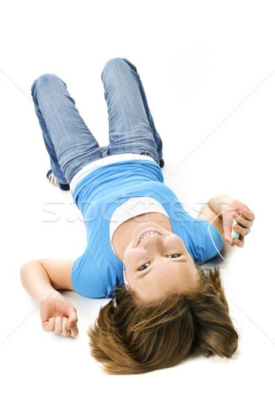 Ouvir música mp3 player fundo meninas fones de ouvido Foto stock © elenaphoto
