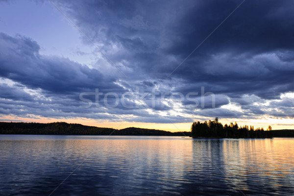Dramatic sunset at lake Stock photo © elenaphoto