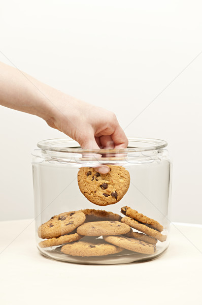 Stealing cookies from the cookie jar Stock photo © elenaphoto