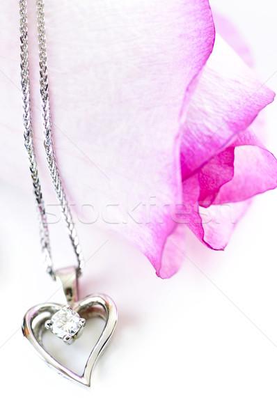 Diamond necklace on rose Stock photo © elenaphoto