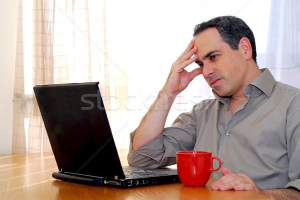Man with laptop Stock photo © elenaphoto