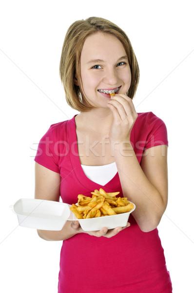 Adolescente frites françaises adolescent manger isolé blanche Photo stock © elenaphoto
