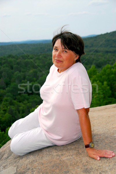 Woman edge cliff Stock photo © elenaphoto