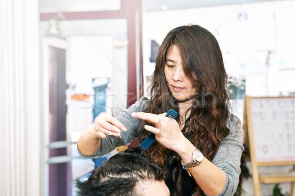 Haj stylist dolgozik boldog fodrász vág Stock fotó © elenaphoto
