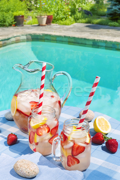 Stock photo: Strawberry lemonade at pool side