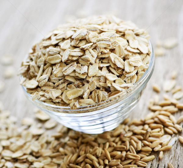 Bowl of uncooked rolled oats Stock photo © elenaphoto
