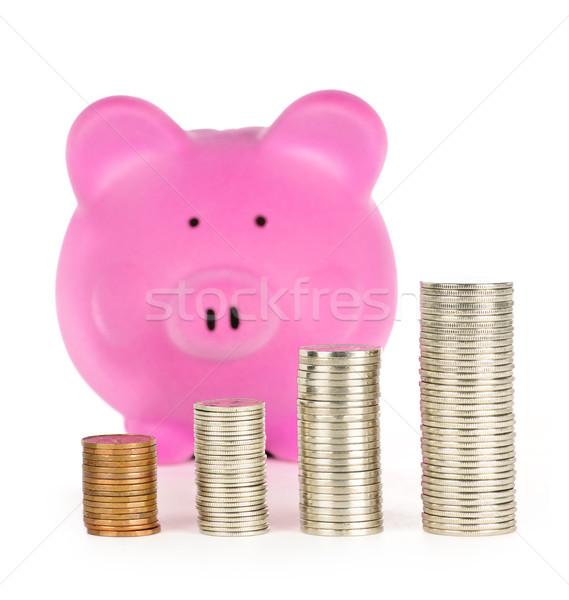 Piggy bank with coin stacks Stock photo © elenaphoto