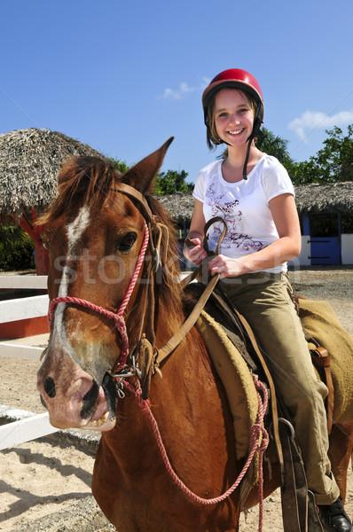 Girl riding horse Stock photo © elenaphoto