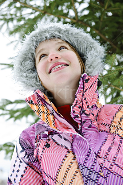 Happy young girl in winter jacket Stock photo © elenaphoto