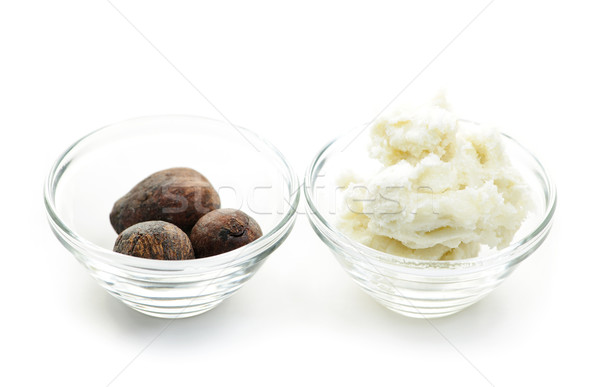 Shea butter and nuts in bowls Stock photo © elenaphoto