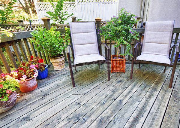 Chairs on wooden deck Stock photo © elenaphoto