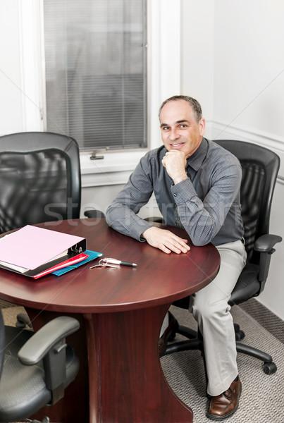 üzletember ül iroda tárgyalóterem középkorú üzletember Stock fotó © elenaphoto