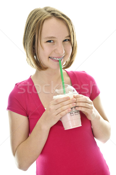 Tienermeisje drinken aardbei geïsoleerd witte Stockfoto © elenaphoto