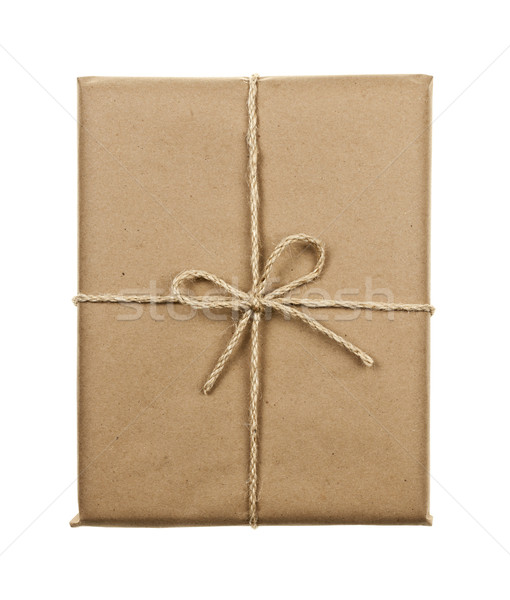 Gift in brown paper tied with string Stock photo © elenaphoto