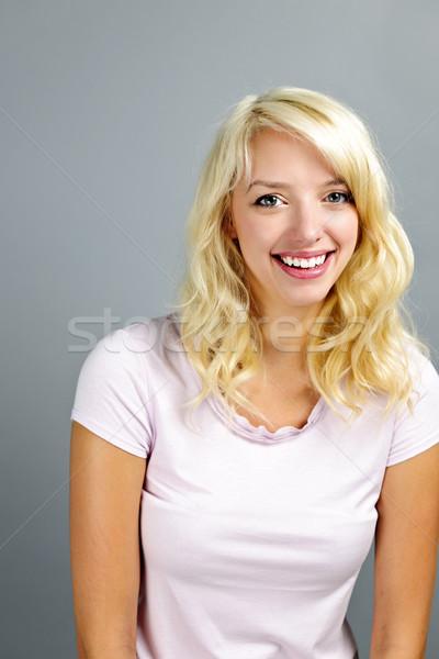 Happy young woman smiling Stock photo © elenaphoto