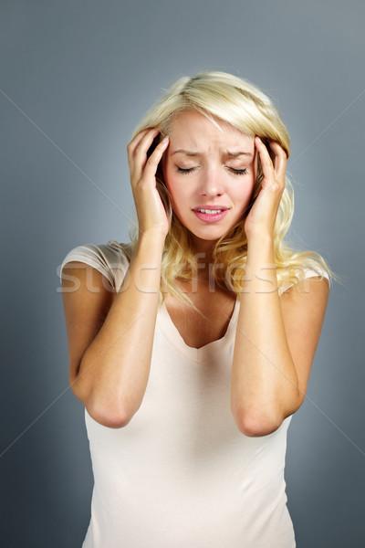Unglücklich Frau halten Kopf verärgert jungen Stock foto © elenaphoto