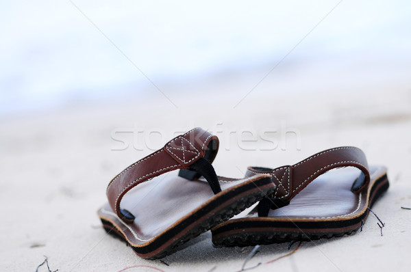 Stock photo: Flipflops on a sandy beach