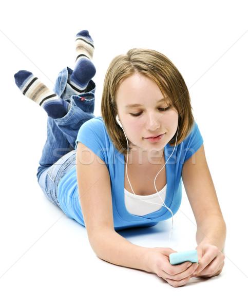 Słuchanie muzyki mp3 player tle dziewcząt słuchawki Zdjęcia stock © elenaphoto