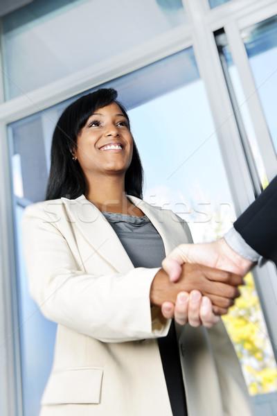 Business woman shaking hands Stock photo © elenaphoto