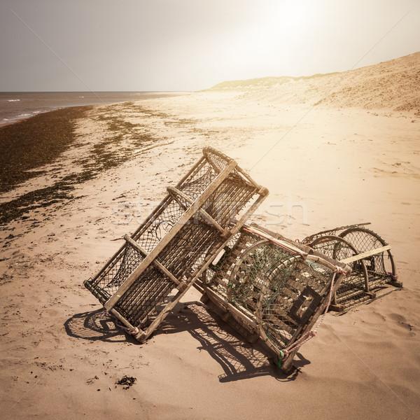 Lobster traps on beach Stock photo © elenaphoto