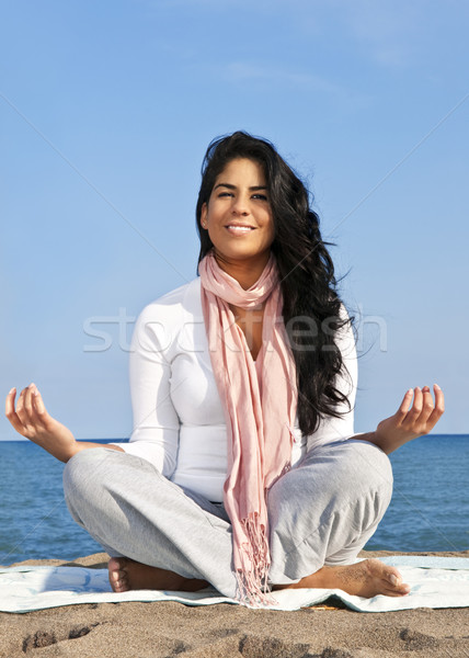 Young native american woman meditating Stock photo © elenaphoto