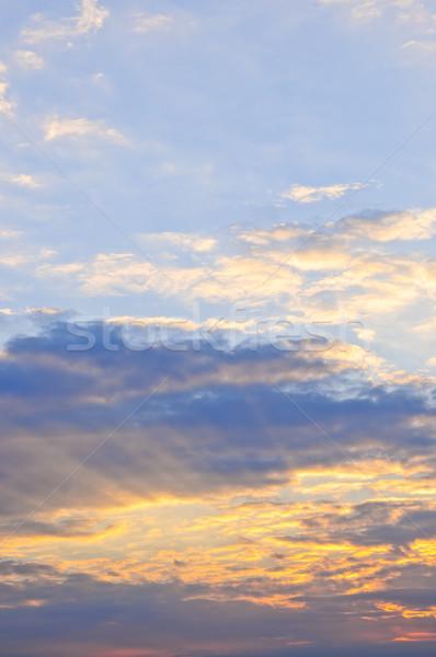 Stockfoto: Zonsondergang · hemel · blauwe · hemel · zonnestralen · heldere · wolken